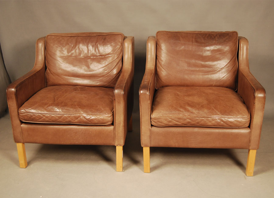 ... Pair Of Stouby Brown Leather Armchairs